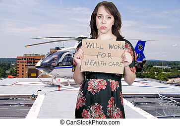 Will Work for Healthcare - A beautiful woman holding a sign...