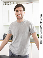 Young Man Relaxing In Modern Kitchen