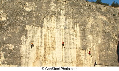 Group of athletes on the rock - A team of professional...
