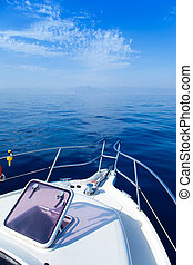 Blue sea boat sailing with open bow porthole