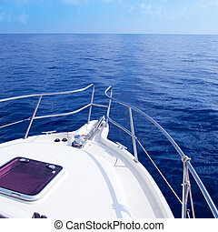 Boat bow sailing in blue Mediterranean sea in summer...