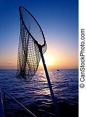 dip net in boat fishing on sunrise saltwater - dip net in...