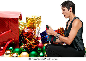 Woman Holding a Christmas Ornament - A beautiful woman...