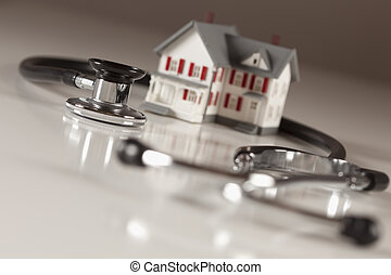 Stethoscope with Small Model Home - Stethoscope and Model...