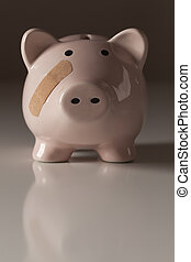 Piggy Bank with Bandage on Face on Gradated Background.