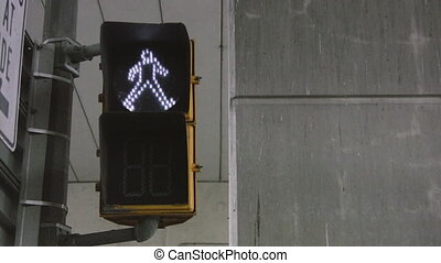 Crosswalk signal - A crosswalk signal changes from a...