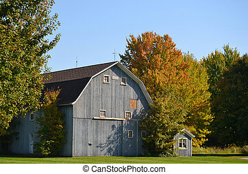 old blue barn - Blue barn with fall foliage