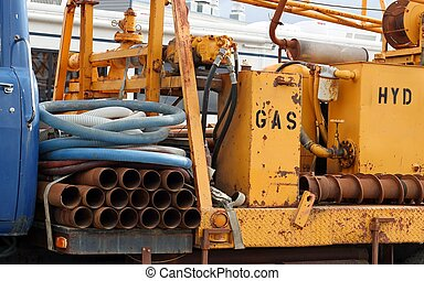 Portable industrial well drilling rig on an old truck -...