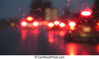 Rainy highway Braking - Driving on a rainy highway in the...