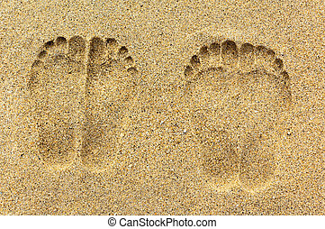 Foot prints on the sand - Two pairs of foot prints on the...