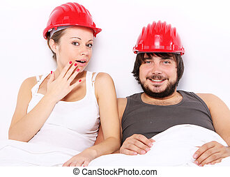 Couple with hard hats on heads - Safe sex concept - Young...