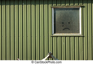 crying smile - wooden wall with drown crying smile on the...