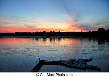 sunset on Po river - sunset colours reflected on Po river,...