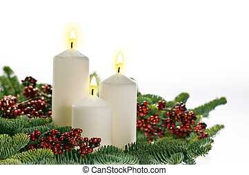 Three candles in advent setting with real Christmas tree...