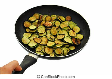 cooked cougrettes with rosemary in frying pan on white background