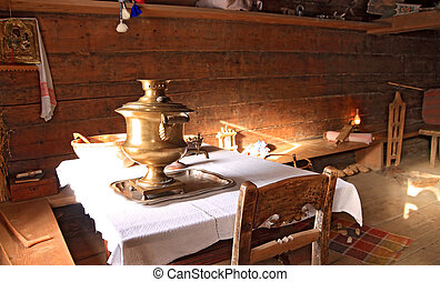 old samovar in wooden house