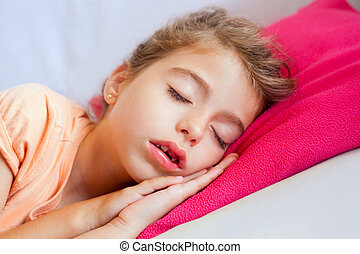Deep sleeping children girl closeup portrait on pink pillow