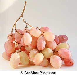Bunch of pink grapes in sunlight