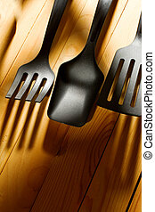 Kitchen utensil collection isolated on wooden background