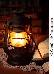 Old oil lamp and old books