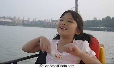 Kid playing on the boat