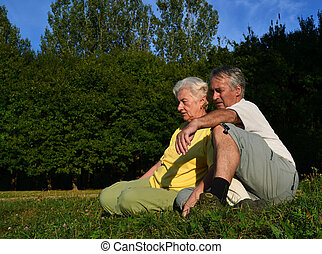 Senior couple relaxing - A retired couple sitting and...