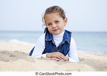 Portrait of cute young girl on the beach