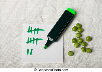 peas and a tally sheet