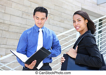 Diverse Business Team at Office Building - A diverse man and...