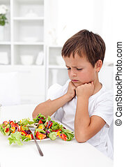 I will not eat that - boy with aversion towards his...
