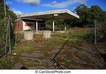 End of the Oil Age - Abandoned vandalised derelict filling...