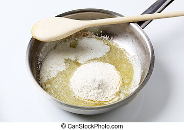 Preparing bechamel - Wheat flour and heated butter in a...