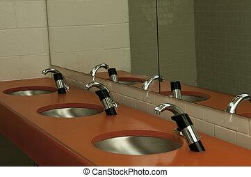 basins - hand washing sinks in a public washroom