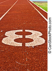 Number eight on the start of a running track