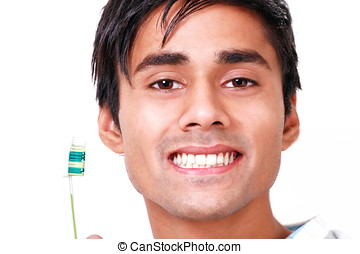 Teeth care - Young man with toothbrush showing his perfect...