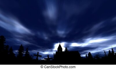 Church and crosses in silhouette on dark night