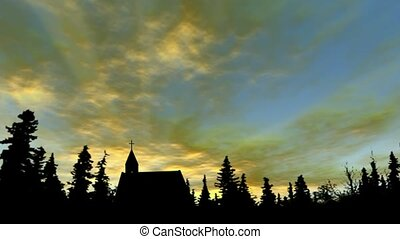 Church and trees in silhouette