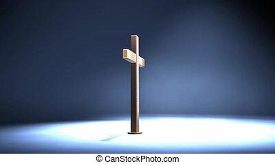 Wood cross in spotlight