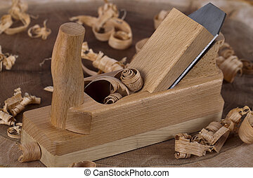 Wooden plane hand-tool with wood shavings.