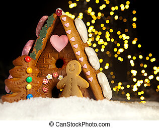 Gingerbread house and men - Funny gingerbread man in front...