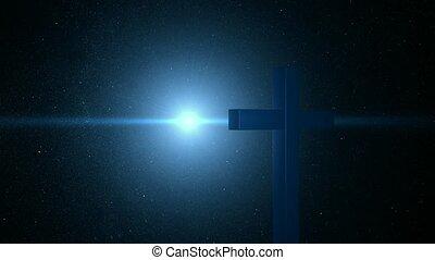Spotlight on cross at night