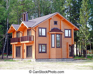 Wooden cottage in the forest