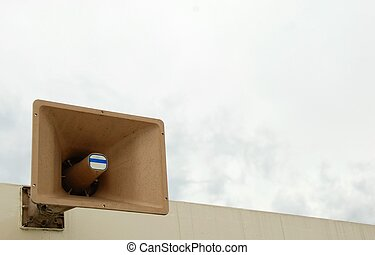 PA Speaker - A PA speaker mounted on a roof