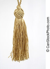 tassel background - Gold rope with tassel isolated on white