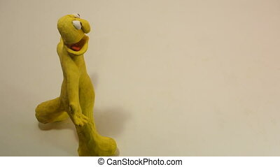 grumbling - yellow plasticine whiner enters the scene and...