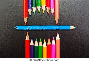 Conceptual photo of pencils representing a mouth of a monster