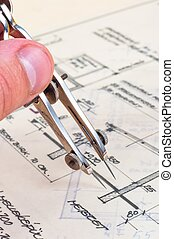 Hands of an engineer with construction plans