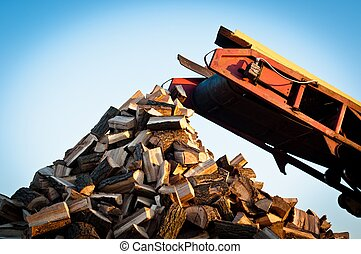 Firewood comes out of a machine