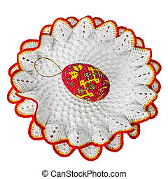paschal eggs - a paschal egg on a lace rest