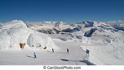 Skiing Whistler - Group of people skiing down off of...
